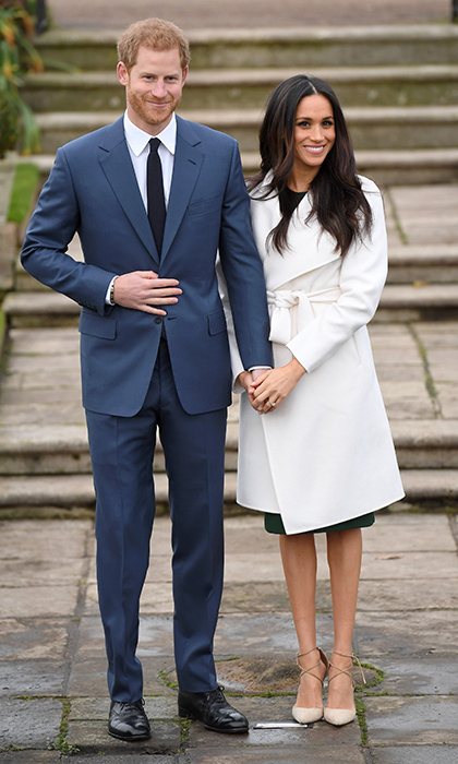 On the day she officially became a royal bride-to-be, Meghan looked ladylike in wedding white! The star wore another coat from LINE and earrings from Birks along with her new diamond engagement ring from now-fiancé Prince Harry. 