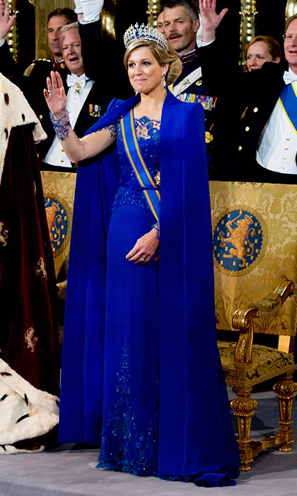 For the day she became Queen, Maxima of the Netherlands chose this regal Jan Taminiau creation in cobalt blue. The floor-length cape worn over an embroidered dress in the same hue was an instantly-iconic combination as husband Willem-Alexander ascended the throne.