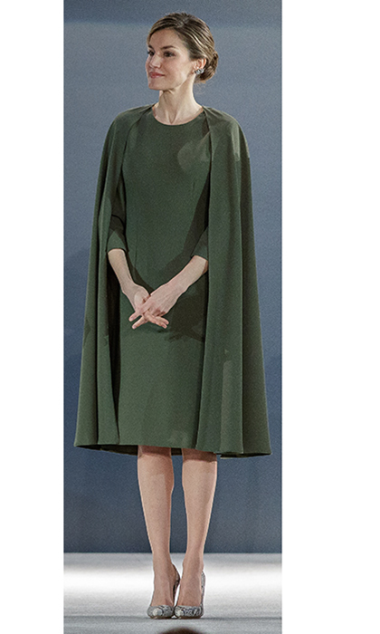 Queen Letizia of Spain was on hand with husband King Felipe to help hand out prizes at the National Design Awards, but we're definitely focused on the design draped over Letizia's shoulders! The forest green look was created by Spanish designer Juanjo Oliva.