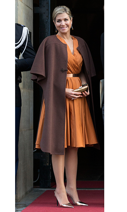 For some daywear inspiration, Queen Maxima of the Netherlands wore this simple brown wool design over a burnt orange dress by Mattijs van Bergen. King Willem-Alexander's wife was attending a New Year's reception for the diplomatic corps at the Royal Palace. 