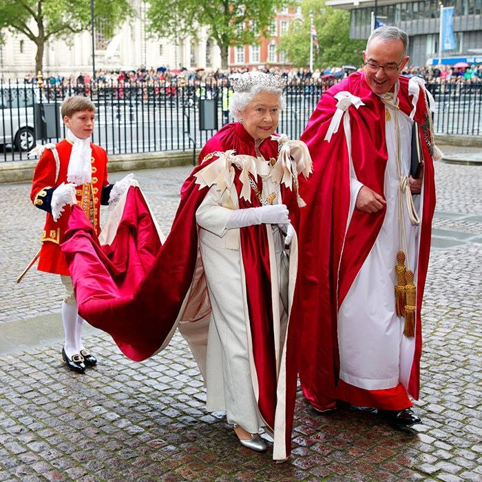 Maybe not the most practical of ensembles, but no royal cape roundup would be complete without the creme de la creme of regal looks, worn by none other than Queen Elizabeth II! Here, the British monarch attends the Service of the Order at London's Westminster Abbey in May 2014. Of course, the downside of getting inspired by this ultimate in royal outfits is that you'll need an assistant to carry your train!