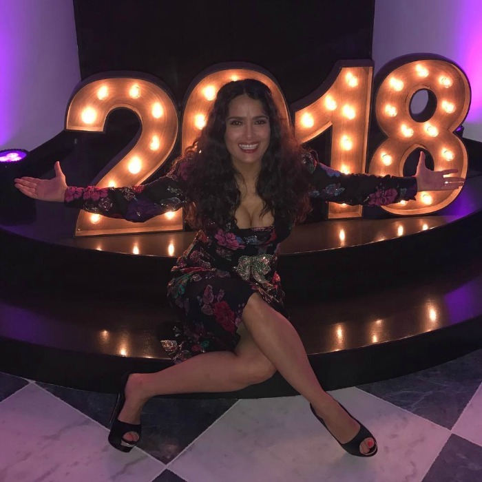 "Happy 2018! Salma Hayek's first Instagram of 2018 was a festive one. The star was all smiles in a picure she shared in the wee hours of the morning, wearing a glittering floral dress as she posed before a bright ""2018"" sign. Her arms were wide open to welcome the new year!