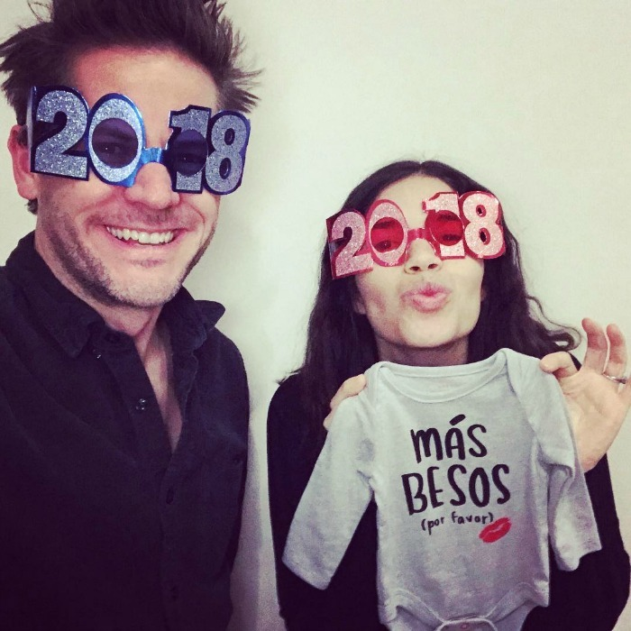 "Baby news! America Ferrera and her husband Ryan Piers Williams rang in the new year by celebrating their big news! The happy couple are expecting their first child together in the coming year. ""We're welcoming one more face to kiss in 2018!"" the 33-year-old wrote alongside an adorable photo of her and Ryan holding up a baby onesie. ""Wishing you #MásBesos in the New Year! #babybesos #HappyNewYear.""