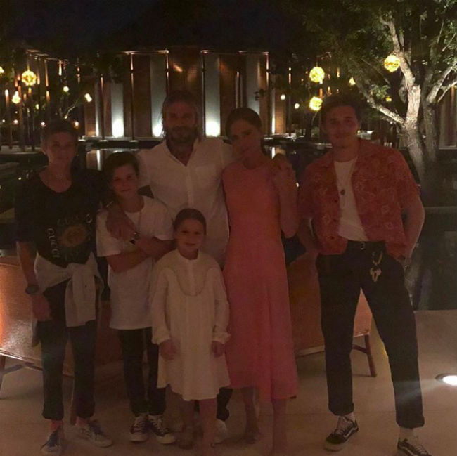 "The Beckham family knows how to party! David and Victoria, along with their children Brooklyn, 18, Romeo, 14, Cruz, 12, and six-year-old Harper, welcomed the New Year in style on Sunday night while on holiday in Turks and Caicos Islands. The close-knit clan had been staying at the luxury Amanyara resort on the island, enjoying an extravagant firework display, and even a live performance from UB40. The former Spice Girl posted a photo showing all six members of the family dressed up ready for the evening's events. ""Happy New Year!! X We love u all!! X kisses from us all!! X @davidbeckham @brooklynbeckham@romeobeckham @cruzbeckham #Harper x,"" she captioned the post.