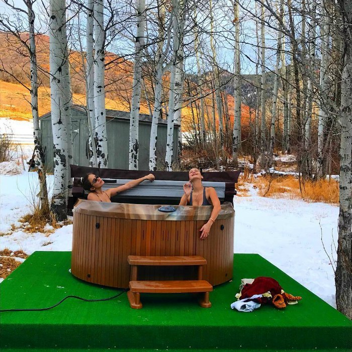 "With a series of stunning Instagrams, Bella Hadid gave fans a gorgeous glimpse at her New Year's weekend in Aspen. In one photo, amongst the snowy trees, the model snuggled up in an outdoor hot tub with her friend on New Year's Eve. She wrote: ""And a happy new year"".