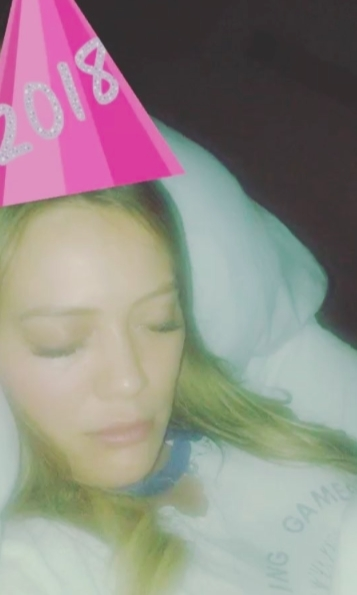 "Hilary Duff was fast asleep before ringing in the New Year! The singer, actress and mother-of-one said goodnight to 2017, but managed to get a snap of it from a friend! She shared the photo on her Instagram with the caption, ""Didn't quite make it to midnight watching the crown it was a real wild night .... happy 2018!!!""