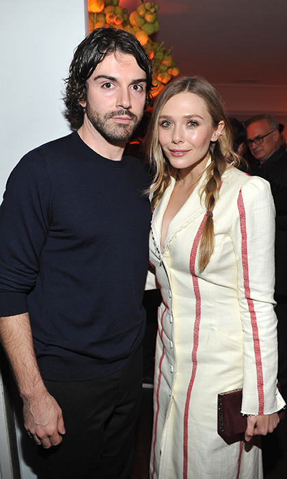 Ever the fashion maven, Elizabeth Olsen looked chic in a striped coat dress alongside her casually-clad boyfriend Robbie Arnett at W Magazine's pre-show extravaganza!