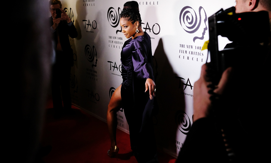 <i>Girls Trip</i> star Tiffany Haddish playe around on the New York Film Critics Awards carpet at TAO Downtown on January 3 in NYC. The funny lady was all glammed up in a silky purple number. She gained attention for her nearly 18-minute acceptance speech which alternated between hilarious jokes and inspirational quips.