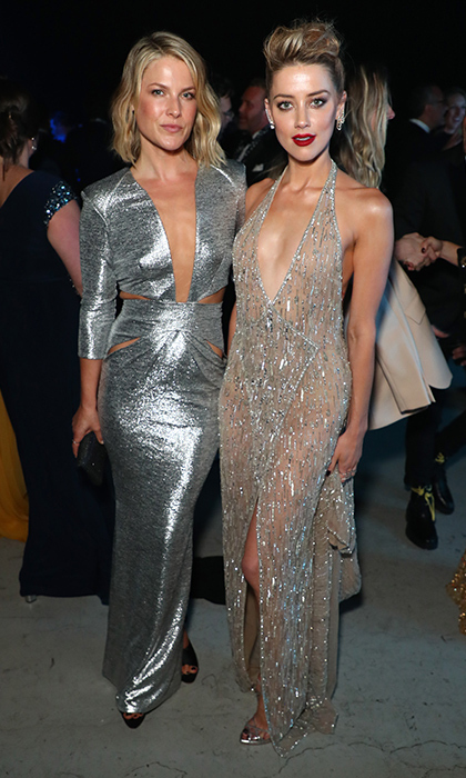 Ali Larter and Amber Heard lit up the event for John Legend's HEAVEN with Art of Elysium in eye-catching silver ensembles. 