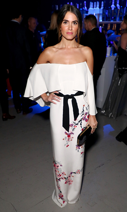 Staying true to her bohemian aesthetic, Nikki Reed wore a floral-embellished white off-the-shoulder gown as she toasted John Legend's HEAVEN with the Art of Elysium on Golden Globes weekend in Santa Monica.