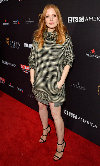 Molly's Game nominee Jessica Chastain descended on the Four Seasons hotel in Beverly Hills for BAFTA's LA Tea Party on Jan. 7, where the presenter paired a casual cool checked dress with strappy stiletto sandals.