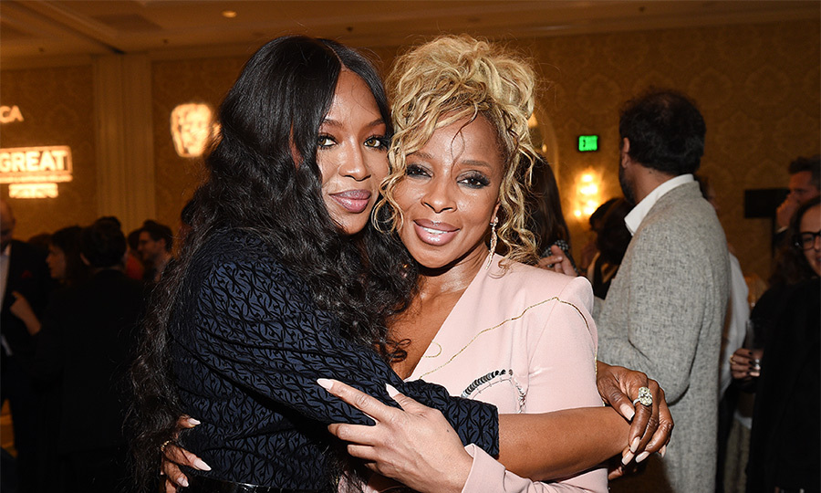 Naomi Campbell gave longtime friend and Golden Globe nominee Mary J Blige a warm embrace at the Heineken-sponsored BAFTA Tea Party, where she wore a gorgeous black gown by the late Azzedine Alaïa.  