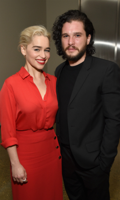 <i>Game of Thrones</i> takes Hollywood! Emilia Clarke and Kit Harington were among the star attendees at the event, which was held at Milk Studios in L.A. The pair happily posed together at the event, with Emilia looking striking in a red buttoned ensemble and Kit turning up in all black.