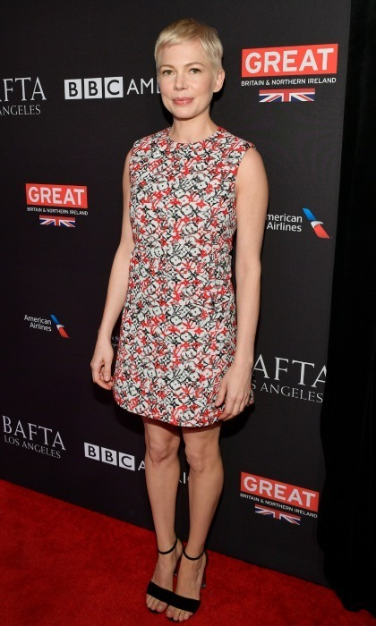 Michelle Williams was among the various celebrities to attend the Heineken sponsored annual BAFTA Los Angeles Tea Party on January 6 at the Four Seasons Hotel. <i>The Greatest Showman</i> star rocked the carpet in a short sleeveless patterned dress, showing off her toned arms and keeping her makeup understated. 