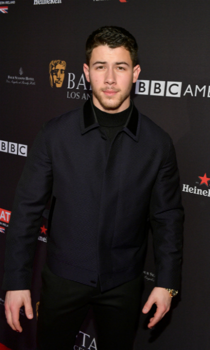 Nick Jonas also turned up for the Hollywood tea party, looking sleek in a modern navy bomber jacket which featured a unique velvet trim around the collar. The <i>Jumanji: Welcome to the Jungle</i> actor kept things cool in a full-on Ermenegildo Zegna Couture outfit.