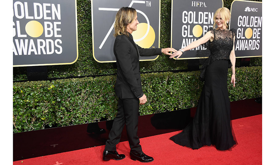 Keith Urban and Nicole Kidman pose together on the red carpet of the 75th Golden Globe Awards. 