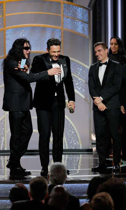 Tommy Wiseau took the stage when James Franco won best actor for his film <i>The Disaster Artist</i>, inspired by the making of Tommy's own work: <i>The Room</i>. The two shared a hilarious moment when the mysterious filmmaker tried to steal the spotlight.