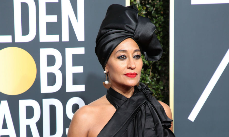 <h4>Tracee Ellis Ross' black turban and bold lip</h4>