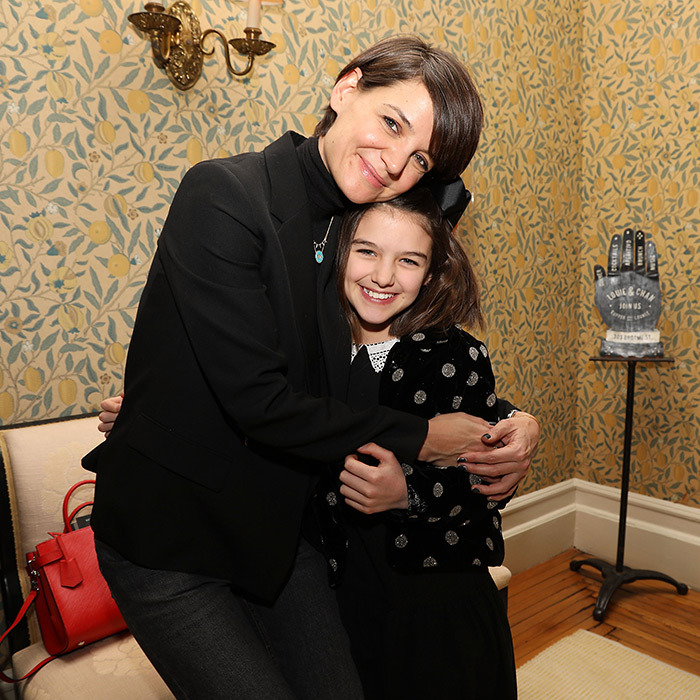 Katie Holmes and Suri Cruise paused for a mother-daughter photo while attending a New York City film screening of <i>Long Strange Trip</i>. The two share an unshakeable bond and are often seen flashing their megawatt smiles at various events!
