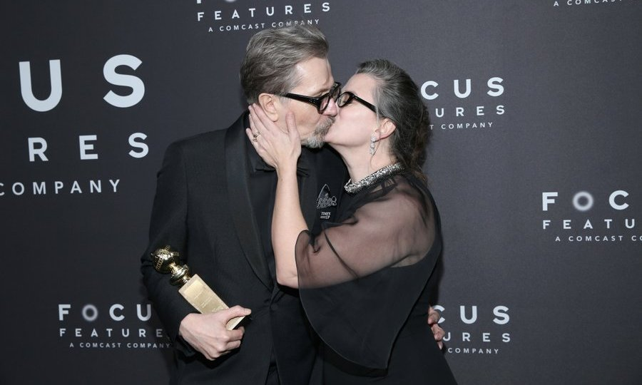<h4>Focus Features After Party</h4><p>Gary Oldman, recipient of the Best Performance by an Actor in a Motion Picture - Drama award for <em>Darkest Hour</em>, received another prize – a kiss from wife Gisele Schmidt – at the Focus Features Golden Globe Awards After Party.<br /><br />Photo: &copy; Phillip Faraone/Getty Images</p>