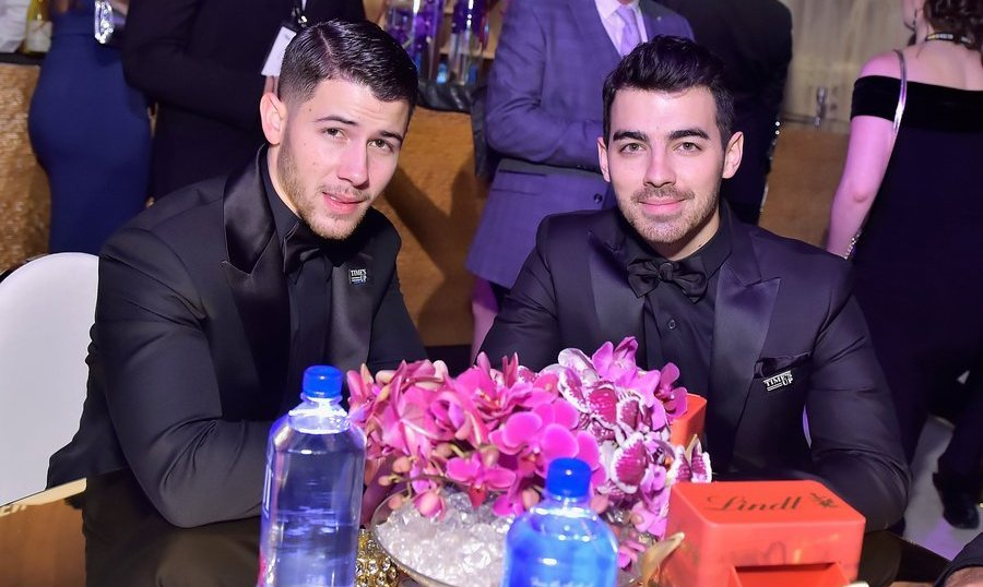 <p>Some stylish sibling bonding! Nick Jonas and Joe Jonas looked sharp at the Beverly Hilton gathering.<br /><br />Photo: &copy; Stefanie Keenan/Getty Images for FIJI Water</p>
