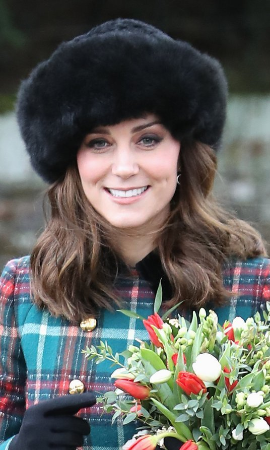 For Christmas 2017 with Queen Elizabeth and the royal family (plus Meghan Markle!), the Duchess set off her plaid Miu Miu coat with a furry black hat as she attended the church service at Church of St Mary Magdalene in King's Lynn, England. 