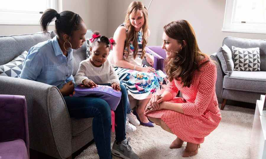 The Duchess of Cambridge had a chat with Kirsty Francois, left, and her two-year-old daughter Teegan-Mia during a parent support group meeting on Mar. 23 at the Best Beginnings charity in London.
