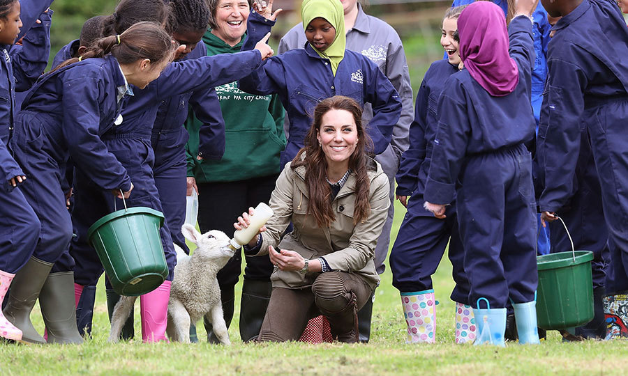 The Duchess of Cambridge looked right at home as she visited Farms for City Children with a host of enthusiastic kids on May 3 in Gloucestershire. The charity offers children in the UK a chance to live and work on a real farm for a week.