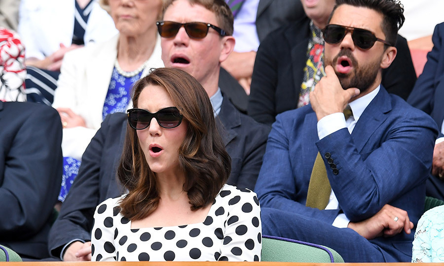 The Duchess of Cambridge and actor Dominic Cooper, behind her, had similar reactions during a tense moment at Wimbledon's opening day on July 3, 2017. 