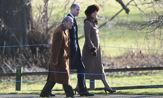 Duchess Kate shared a quiet moment with Prince Philip and her husband Prince William while walking to a morning church service in January 2018. Known for recycling her looks, Kate wore a natural-hued Mohol coat.