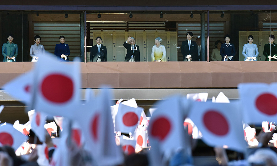 Led by Emperor Akihito and Empress Michiko, center, the Japanese royal family took a look at the flag-waving crowds during the annual New Year's greeting to well-wishers gathered at the Imperial Palace in Tokyo on January 2. 