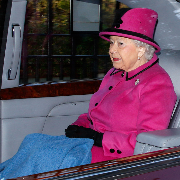 Pretty in pink! Queen Elizabeth II kept the winter chill at bay by draping her legs in a blanket as she left the St Mary Magdalene Sunday service at Sandringham on January 7.