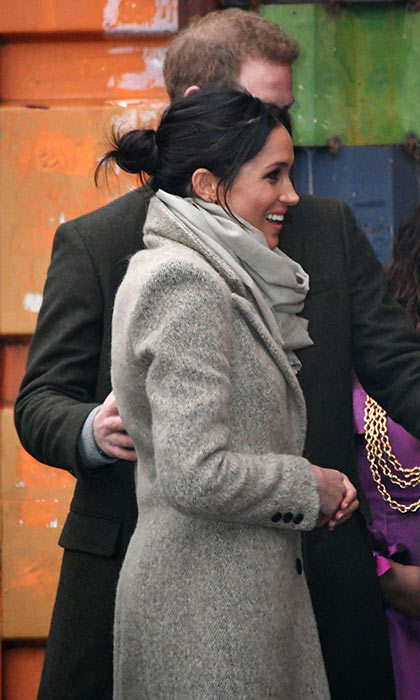 Meghan Markle wore her hair up in a bun for her engagement in Brixton.