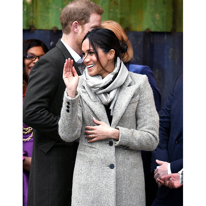 <p>For the outing, Prince Harry's fiancée Meghan opted to wear a $999 grey coat by Symthe, a sweater by Marks &amp; Spencer, trousers by Burberry and a scarf by Jigsaw. She wore her long brunette tresses in a casual bun, a change from her trademark loose waves. Her make-up was typically flawless, with the former <i>Suits</i> actress rocking a warm brown eyeshadow, dark mascara and glossy nude lips.</p>