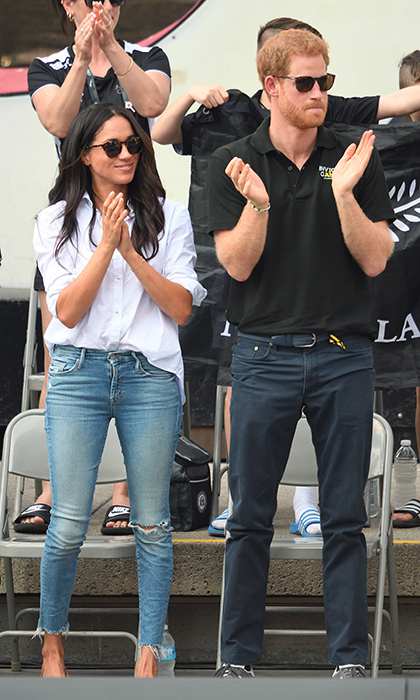 "When Meghan made her relationship with Prince Harry ""official"" for their first joint outing in September 2017, she kept it casual. The actress paired a classic white button-down from designer and close friend Misha Nonoo with distressed Mother Denim Jeans and red Sarah Flint flats. Finally, she sheltered her eyes from the sun with tortoiseshell glasses from Finley and Co.