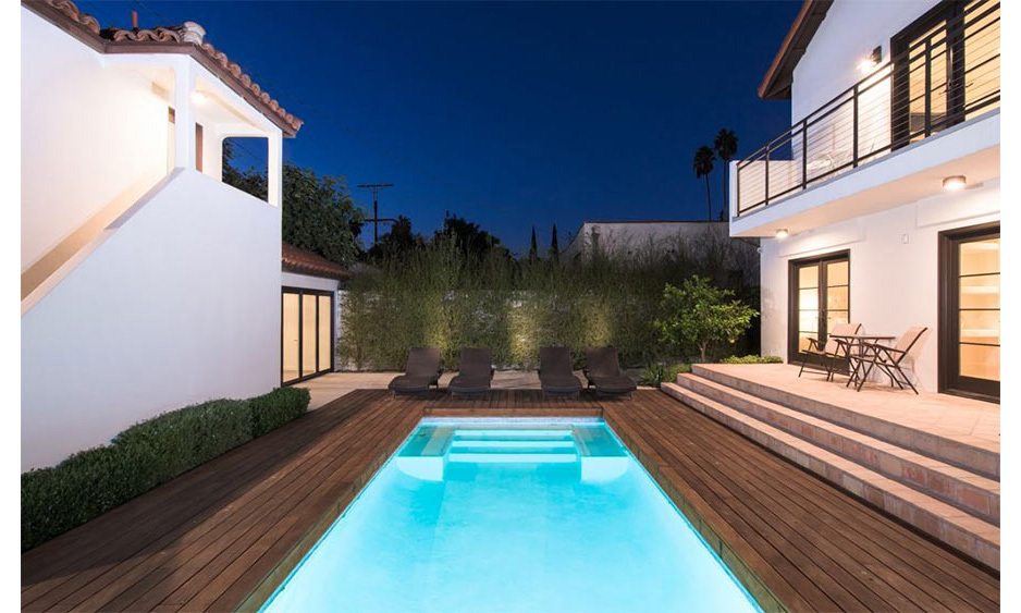 <p>Rihanna's home is surrounded by a pretty garden and courtyard, which comes complete with a private swimming pool. Wooden decking surrounds the pool, while several sun loungers and chairs are lined up to take advantage of the year-round Los Angeles weather.</p>