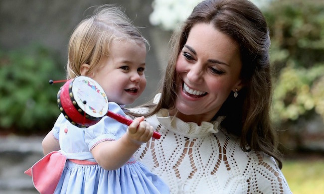 Little Charlotte undertook her first royal tour at just one year old. Joining William, Kate and George in Canada for eight days, the royal cutie sported this baby-blue dress with contrasting pink sash, buttons and stitching. She was also pictured making a dash for the pink balloons at a garden party for military families.