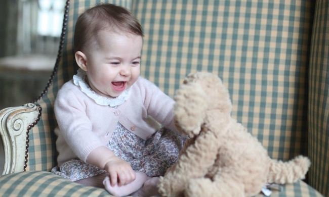 Little Charlotte showed a preference for pink at just six months old. In these snaps, taken by the Duchess at the family's country home Anmer Hall, the Princess sported a pale pink floral dress with frilly collar, pink cardigan and tights, and looked delighted while playing with a cuddly toy dog.
