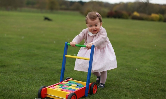 In this gorgeous picture – again taken by her mother Kate – Princess Charlotte wore a pink floral frock, dusky pink with white collar, pink tights and a matching hair clip while playing with her baby walker. The snap was taken at Anmer Hall and released to celebrate the tot's first birthday.