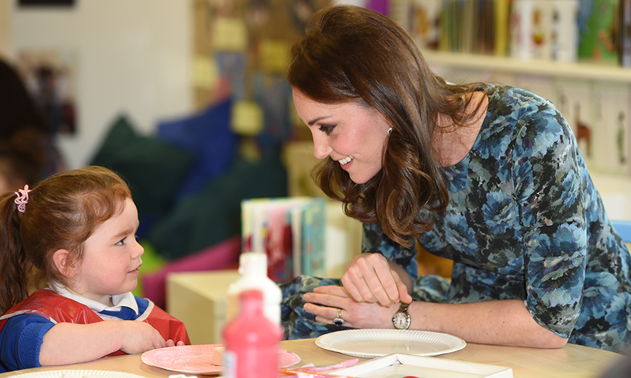Showing her maternal side, the pregnant royal shared a special moment with a little girl while inside the school. Kate was clad in one of her favourite Seraphine maternity dresses, which she wore on two occasions while pregnant with Princess Charlotte.