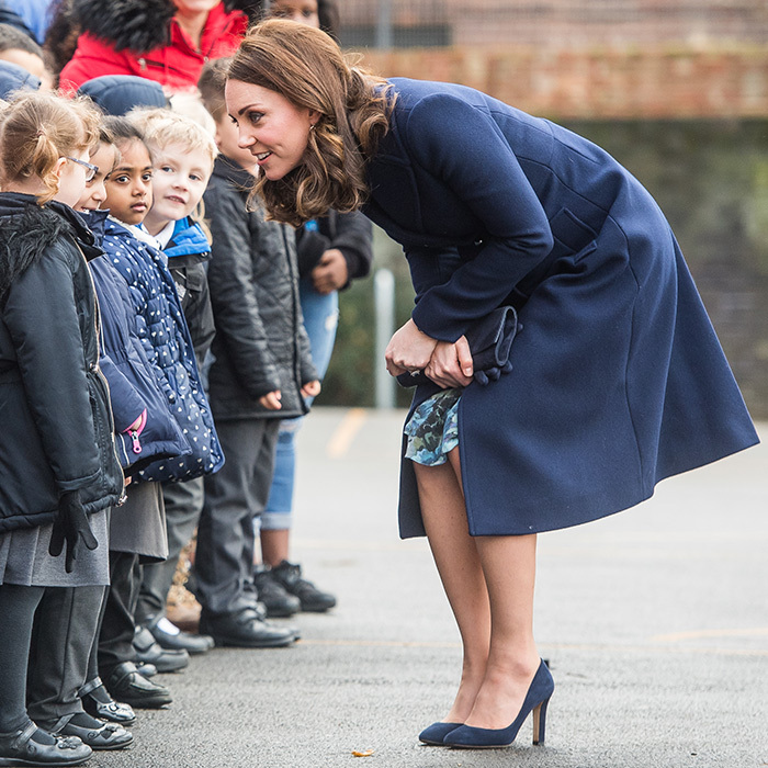 The Duchess of Cambridge bonded with a gaggle of adorable children on a visit to the Reach Academy with Place2Be one of her patronages. 