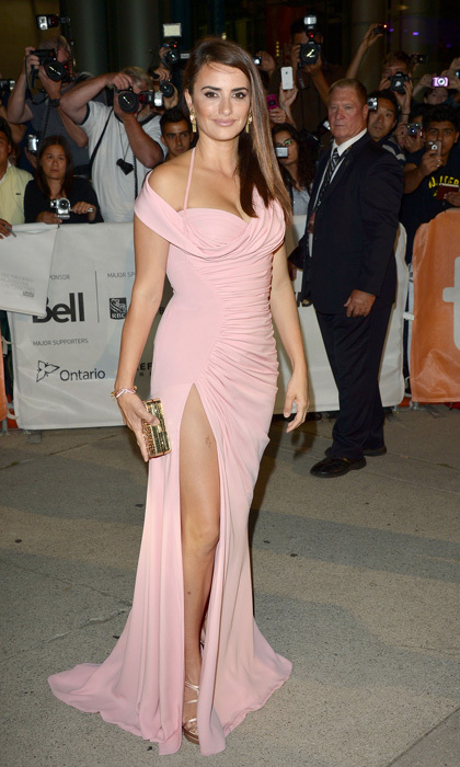 <p>The star of <em>American Crime Story: The Assassination of Gianni Versace</em> looked pretty in pink at the <em>Twice Born</em> premiere during the 2012 Toronto Film Festival. She paired her va-va-voom gown with simple metallic accessories.</p>