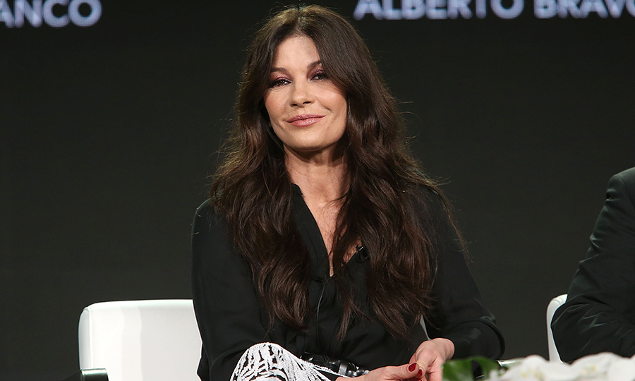 Catherine Zeta-Jones appeared on the A+E Networks' 2018 Winter Television Critics Association Press Tour, representing her latest film <i>Cocaine Godmother</i>. The star stunned in a black-and-white ensemble, with her gorgeous dark locks in relaxed curls, on Jan. 14.