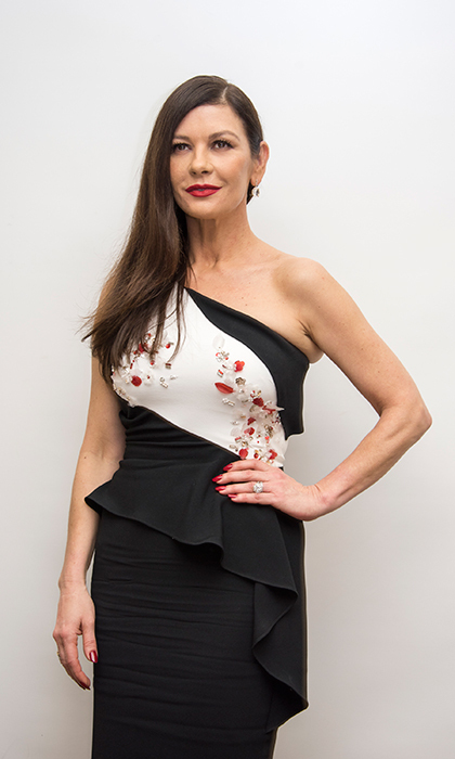 Catherine Zeta-Jones stunned in a beautiful black-and-white dress - with red accents - while attending the press conference for her new film, <i>Cocaine Godmother</i>, on Jan. 13.