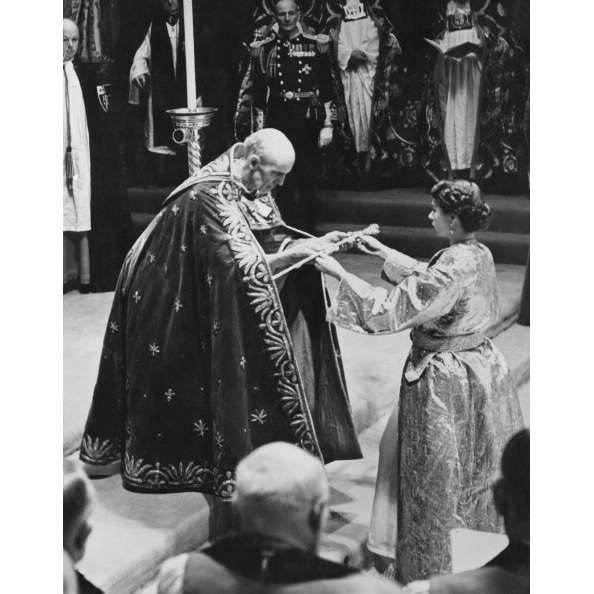 Geoffrey Fisher, the Archbishop of Canterbury, presented the Queen with the Sceptre with the Cross during her coronation, a day filled with pomp and pageantry.