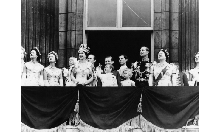 During Queen Elizabeth II's coronation ceremony, the newly anointed monarch and members of her Royal Family stood on the balcony of Buckingham Palace watching RAF fly by.