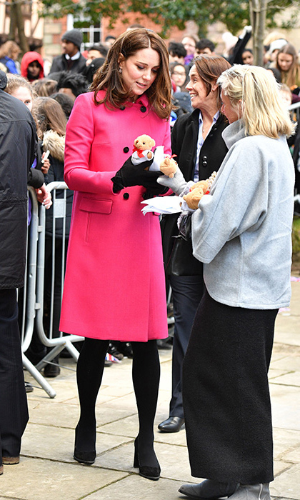 <p>The Duchess of Cambridge wears a pink Mulberry coat in Coventry.</p>