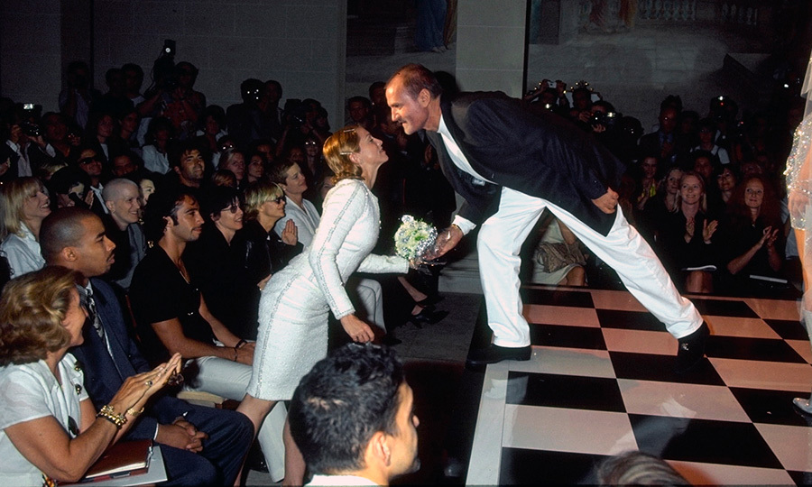 In the '90s Madonna's name was almost synonymous with the designer's, from red carpet appearances to starring in numerous Versace campaigns, Here, at Gianni's Winter 1996 couture show, the designer bent down to kiss the pop icon after presenting his collection, who remains a regular  model for the brand. 