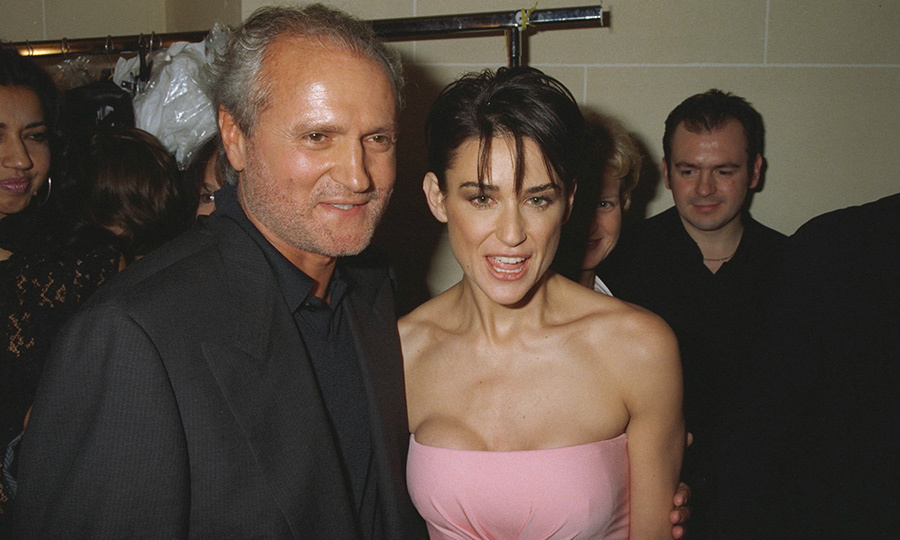 Just eight days before he was shot outside his home in Miami, Demi Moore sat front row at Gianni's couture show in Paris. Clad in a strapless pink minidress, the actress gave an audible cheer as her designer friend took what would be his final bow. 