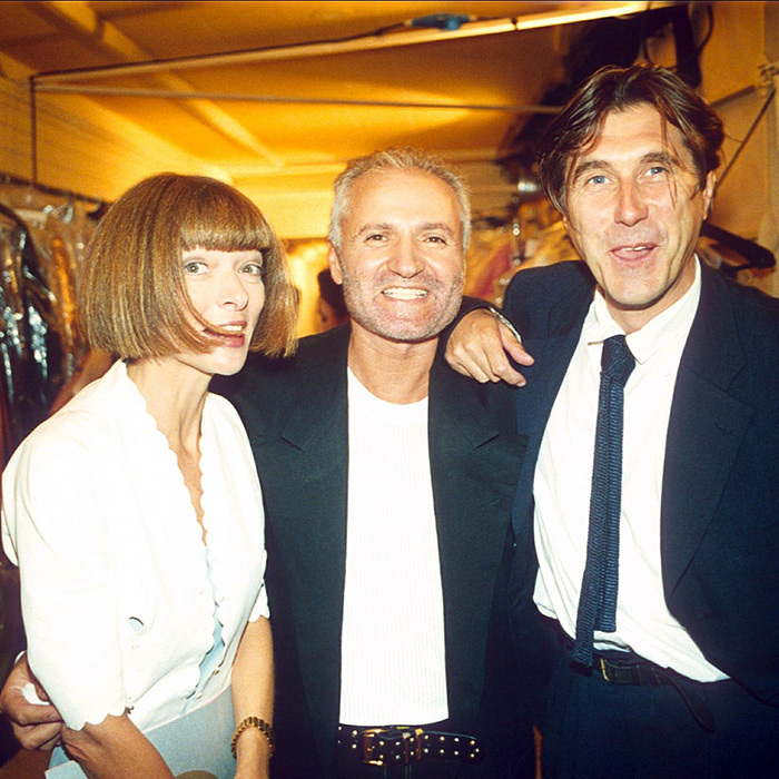 "<em>Vogue</em> editor-in-chief Anna Wintour and singer Bryan Ferry flanked the designer at his 1994 show in Paris. Gianni and Anna were close friends for more than a decade, and she stated in an interview following his death that, ""He had enormous love for life. He adored what he did and he surrounded himself with people he loved to be with."" She also described him as a marketing genius, saying, ""Gianni understood the important of fashion as a global package. He was the first to introduce superstars on the runway, he was the first to bring the celebrities into the front rows, he was the first to use the rock stars and the actresses in his advertising campaigns.""